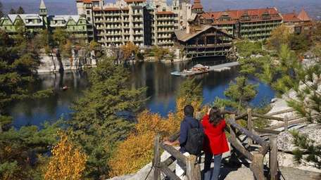 A couple views the Mohonk Mountain House from