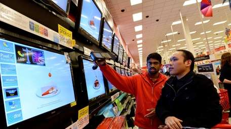 Jerome Quilaton, 39, of Bethpage, browses flatscreen TVs