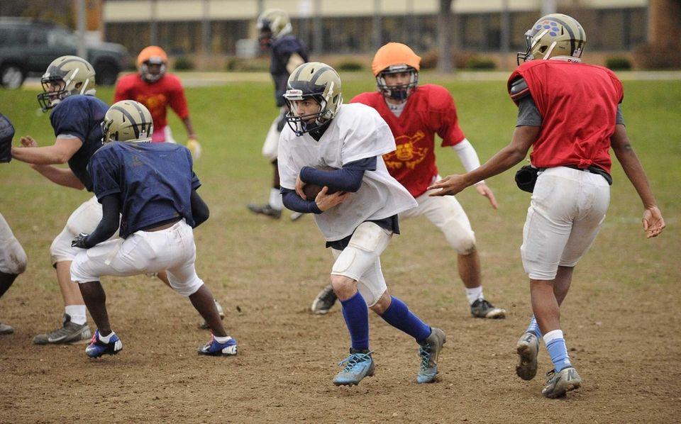 Baldwin quarterback Joe LoBello protects the ball during