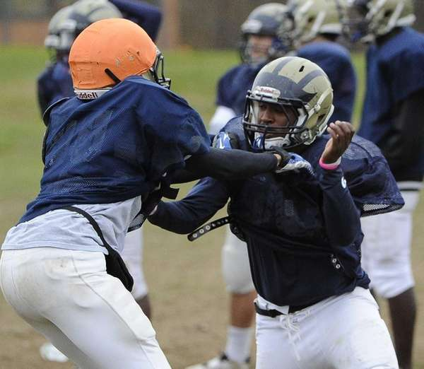 Baldwin RB/LB Michael Abrahams, right, runs a play