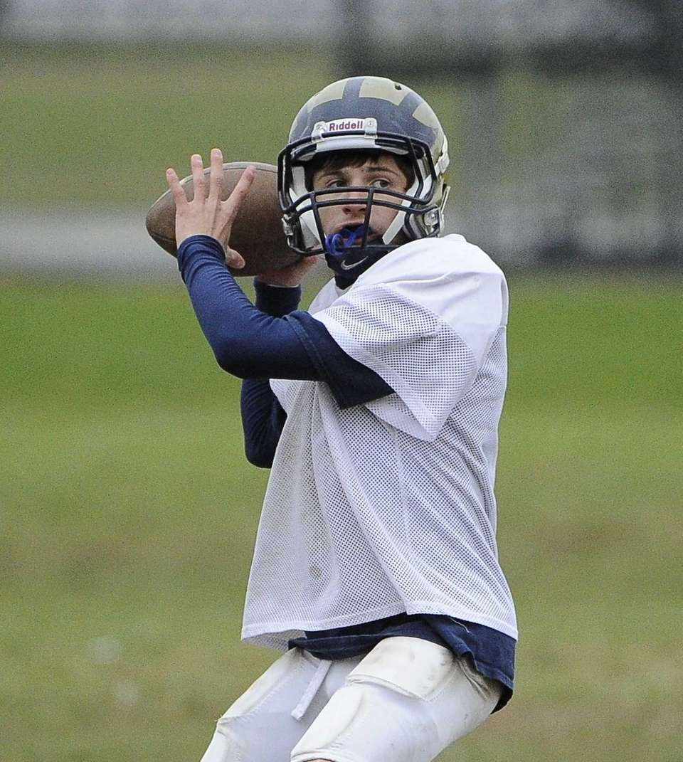 Baldwin quarterback looks to pass during football practice