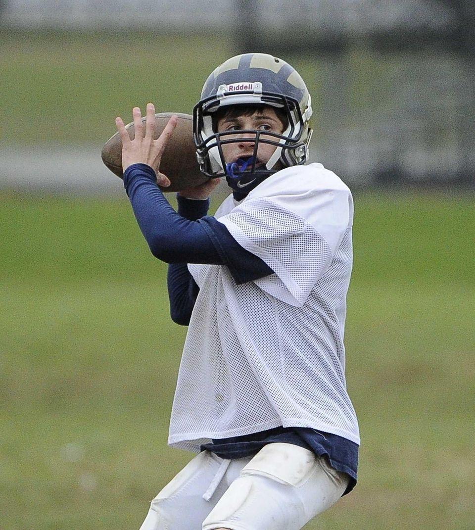 Baldwin quarterback looks to pass during football practice