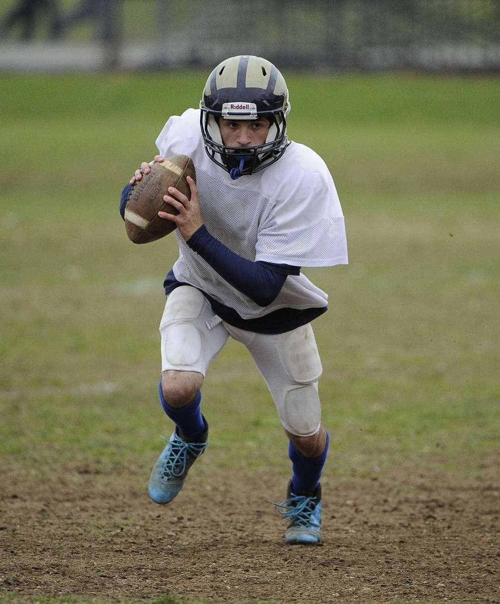 Baldwin quarterback Joe LoBello runs a play during