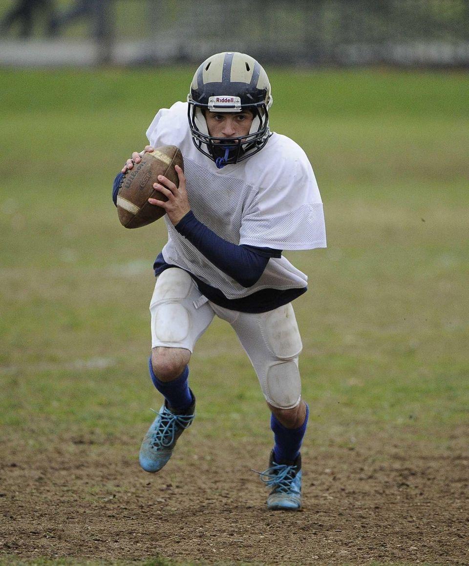 Baldwin quarterback Joe LoBello runs a play during