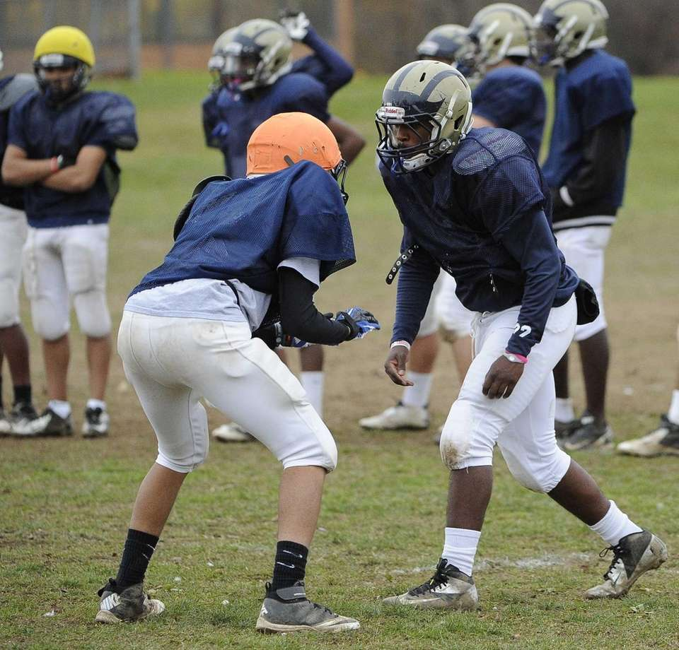 Baldwin RB/LB Michael Abrahams, right, sets up to