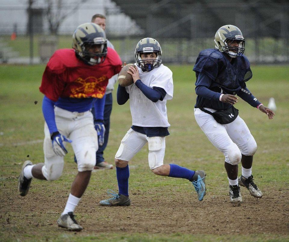 Baldwin quarterback Joe LoBello looks to pass during