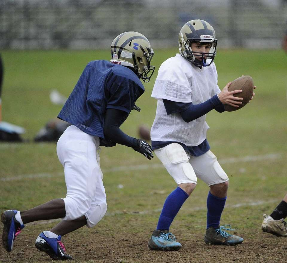 Baldwin quarterback Joe LoBello looks to hand off