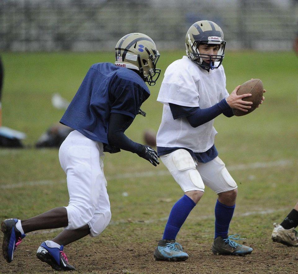 Baldwin quarterback Joe LoBello looks to hand off