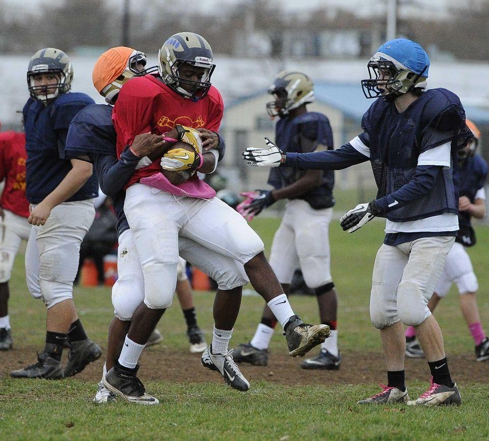 Baldwin WR/DB Travais Hylton protects the ball during