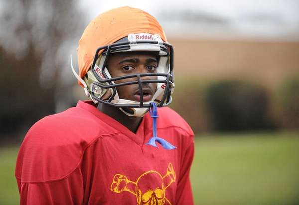Baldwin WR/DB Travais Hylton looks on during football