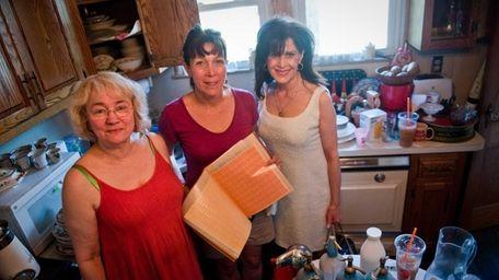 TAG SALE: Betsy Wilczek, left, Madeleine Winn, center,