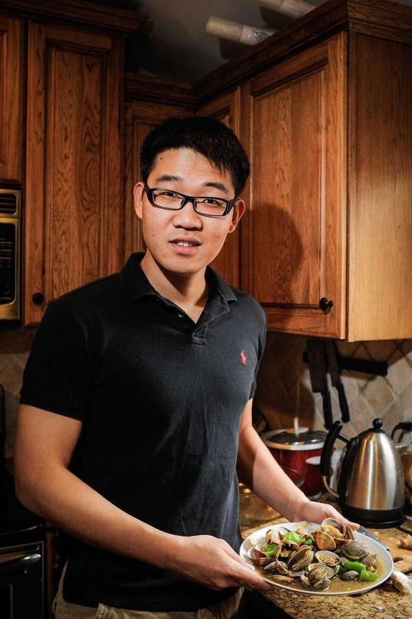 Rui Yang with his dish of spicy clams.