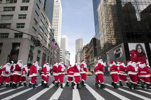Dozens of jolly Saint Nicks march along Fifth