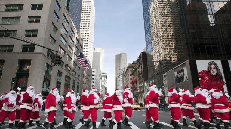 Dozens of jolly Saint Nicks march along Fifth