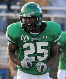 Farmingdale's Kevin Petit-Frere reacts after making a tackle