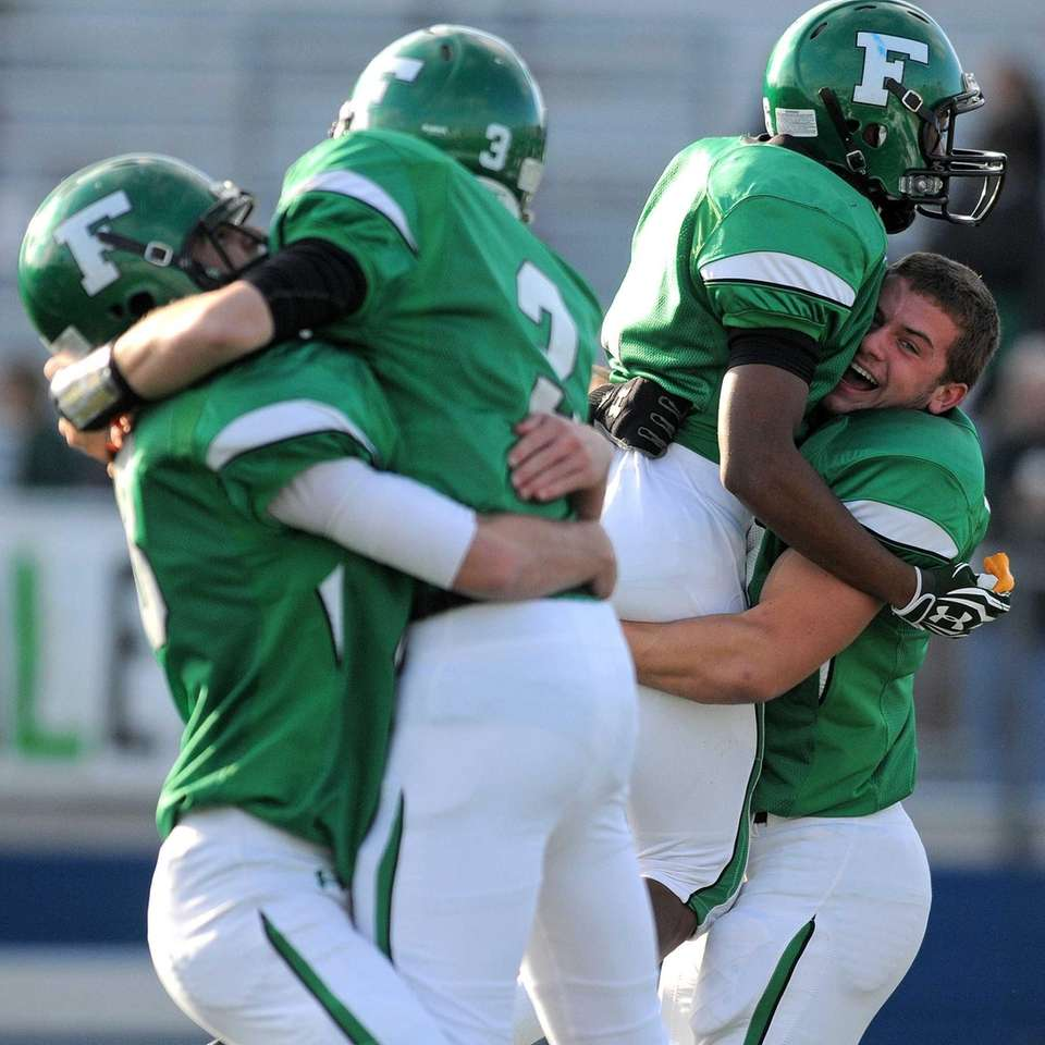 Farmingdale players celebrate after their 21-9 win over