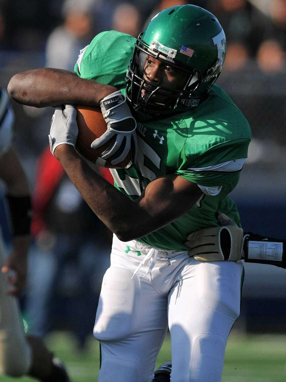 Farmingdale running back Kevin Petit-Frere protects the ball