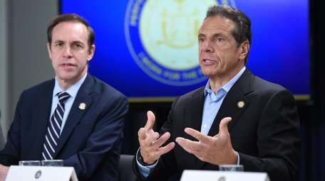 Gov. Andrew M. Cuomo with state Health Commissioner