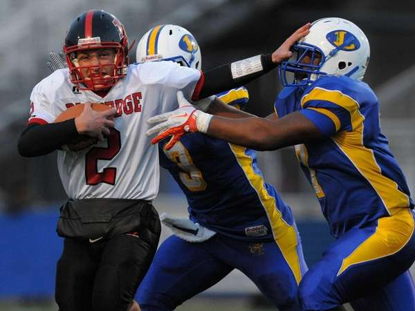 Plainedge's Nick Frenger, left, fights for yards while