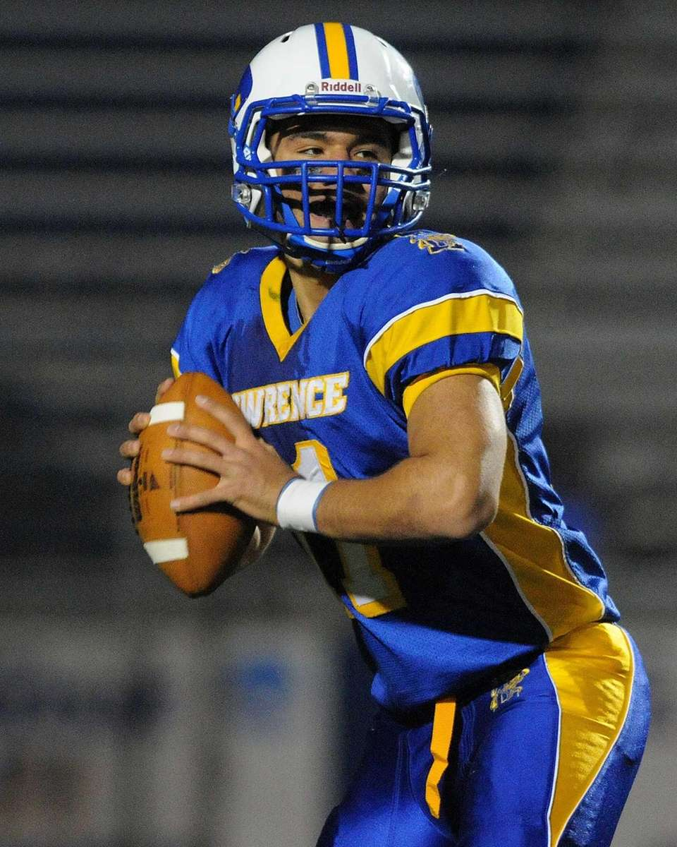 Lawrence quarterback Joe Capobianco looks for an open
