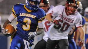 Lawrence running back Tyler Fredericks rushes for a