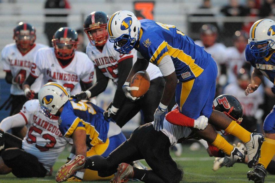 Lawrence running back Tyler Fredericks leaves his feet