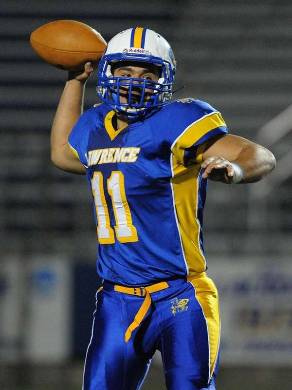 Lawrence quarterback Joe Capobianco throws a pass during