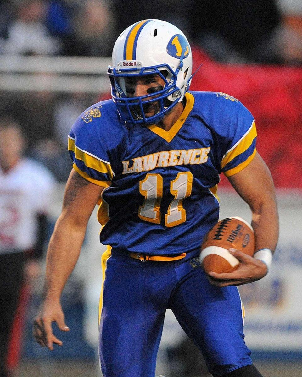 Lawrence quarterback Joe Capobianco runs the ball on