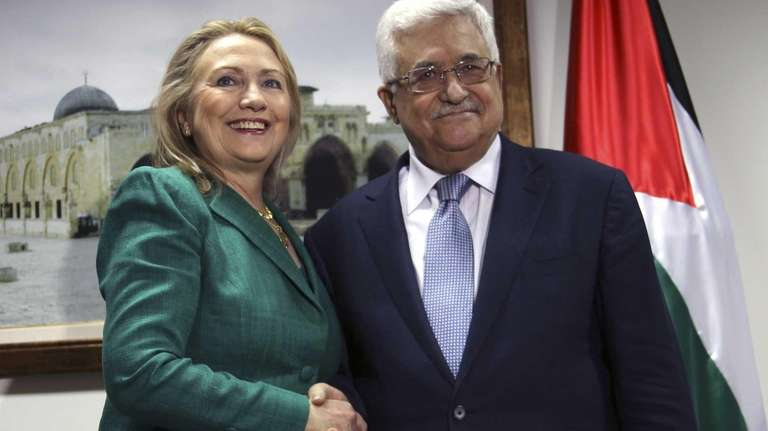 Secretary of State Hillary Rodham Clinton, left, shakes
