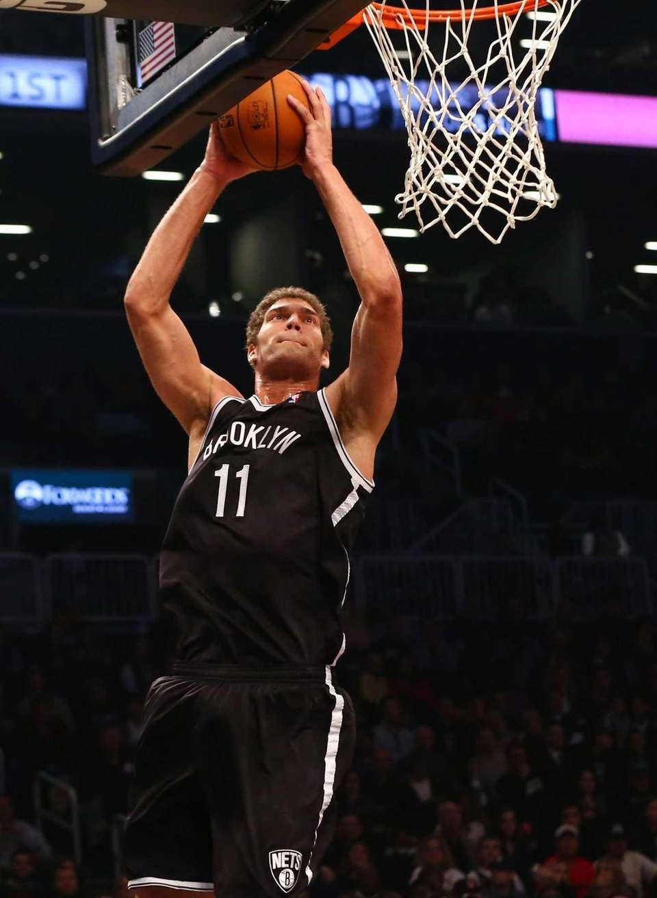 Brook Lopez puts up a shot for a