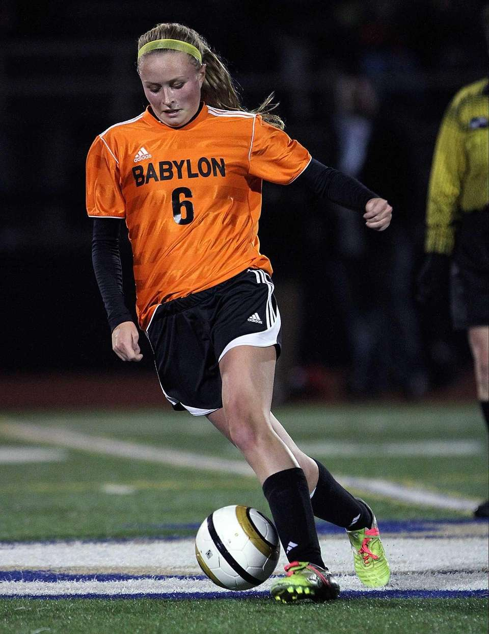 Babylon's Carolanne Murphy dribbles the ball at midfield