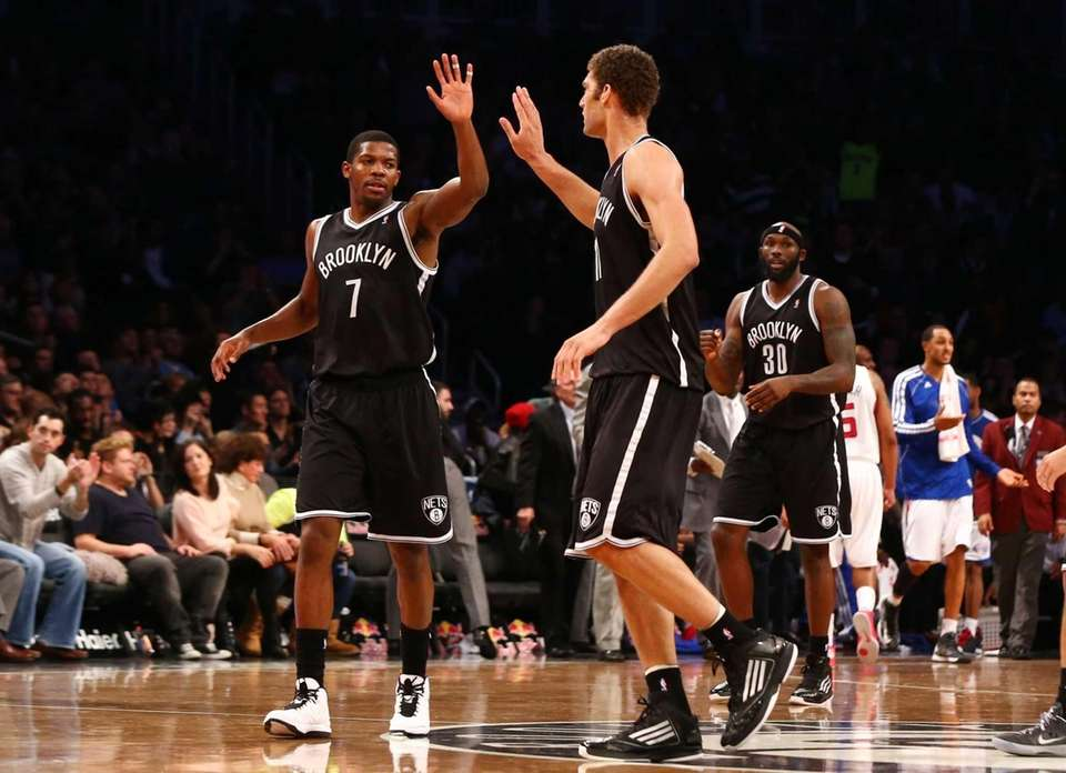 Brook Lopez celebrates a second-half basket with Joe