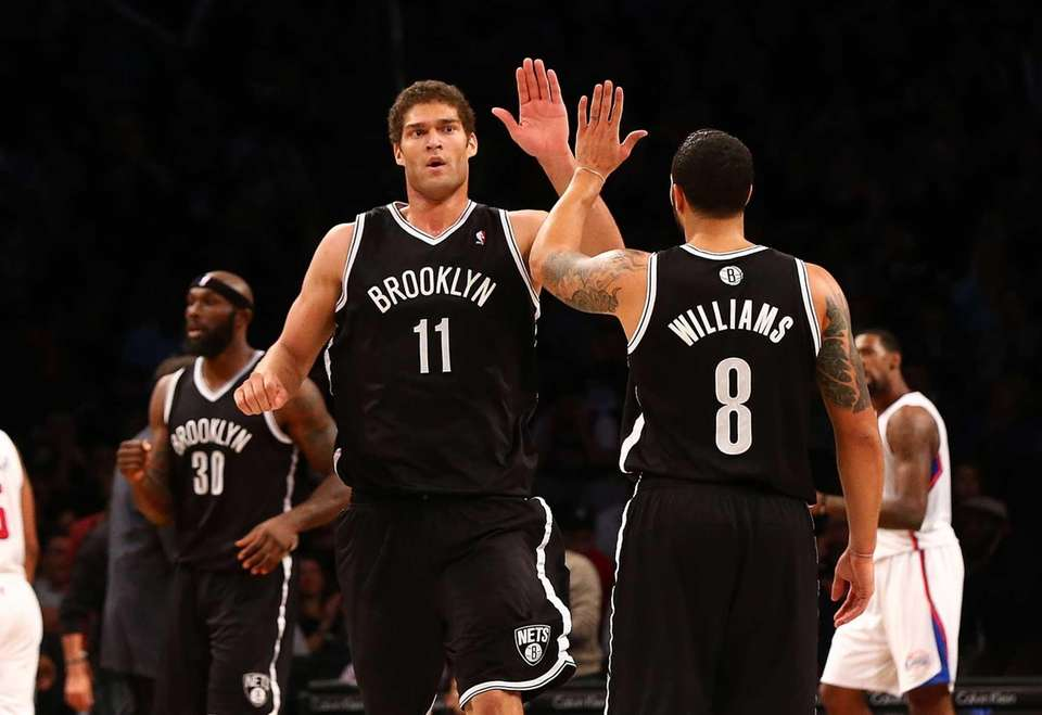 Brook Lopez celebrates a second-half basket with Deron
