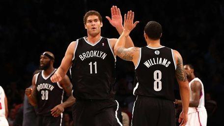 Brook Lopez celebrates a second-half basket with Deron