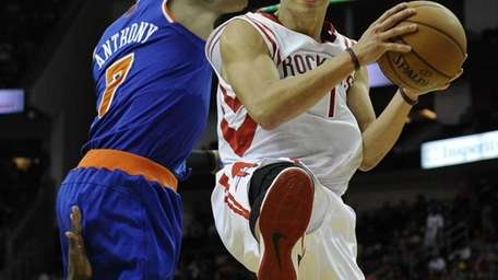 Houston Rockets' Jeremy Lin, right, goes to the