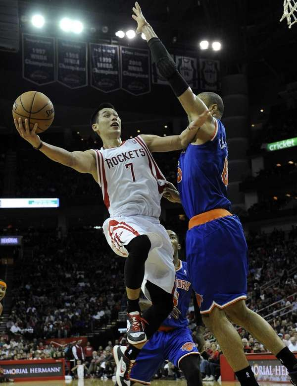 Houston Rockets' Jeremy Lin tries to shoot around
