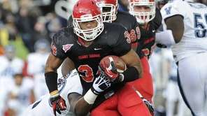 Stony Brook's Marcus Coker drives the ball against