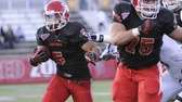 Stony Brook's Miguel Maysonet rushes as Cody Precht