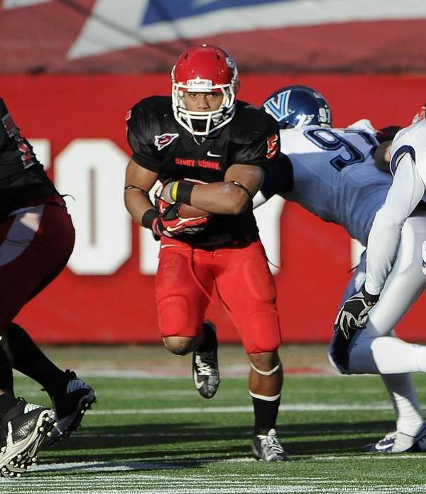 Stony Brook's Miguel Maysonet carries the ball against