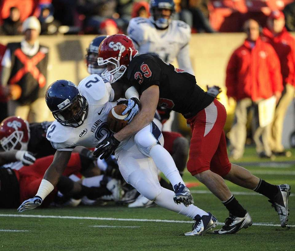 Stony Brook's Christian Ricard tackles Villanova's running back