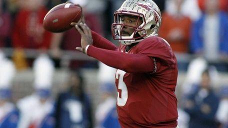 Florida State quarterback EJ Manuel throws a pass