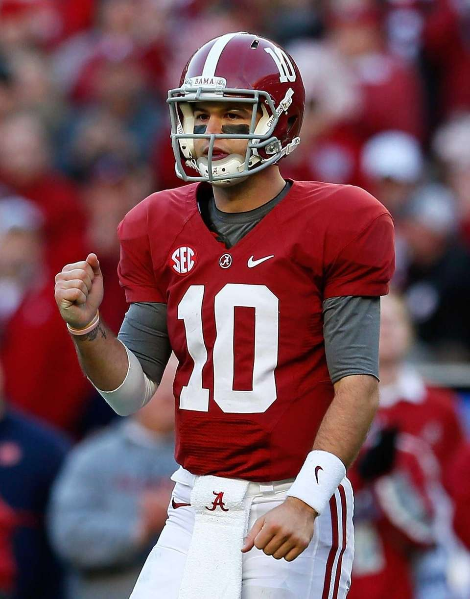Alabama's AJ McCarron reacts after a touchdown during