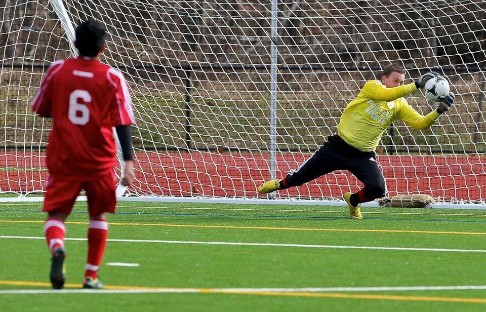 Suffolk All-Star goalkeeper Sean McAllister makes a save