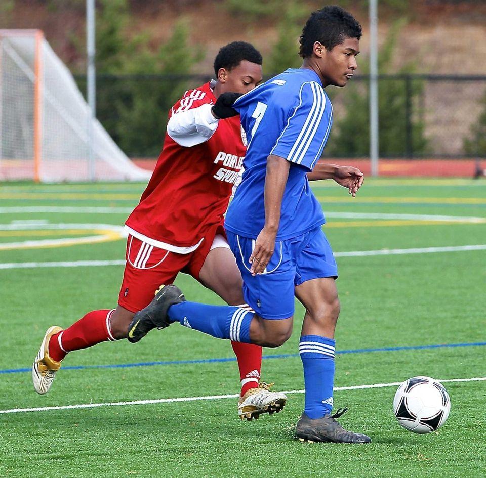 Nassau All-Star Esosa Aluyi gets held by Suffolk
