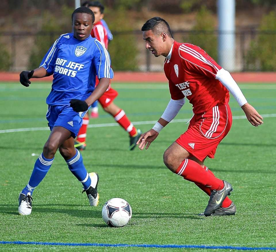Suffolk All-Star Jonathan Interiano dribbles by Nassau All-Star