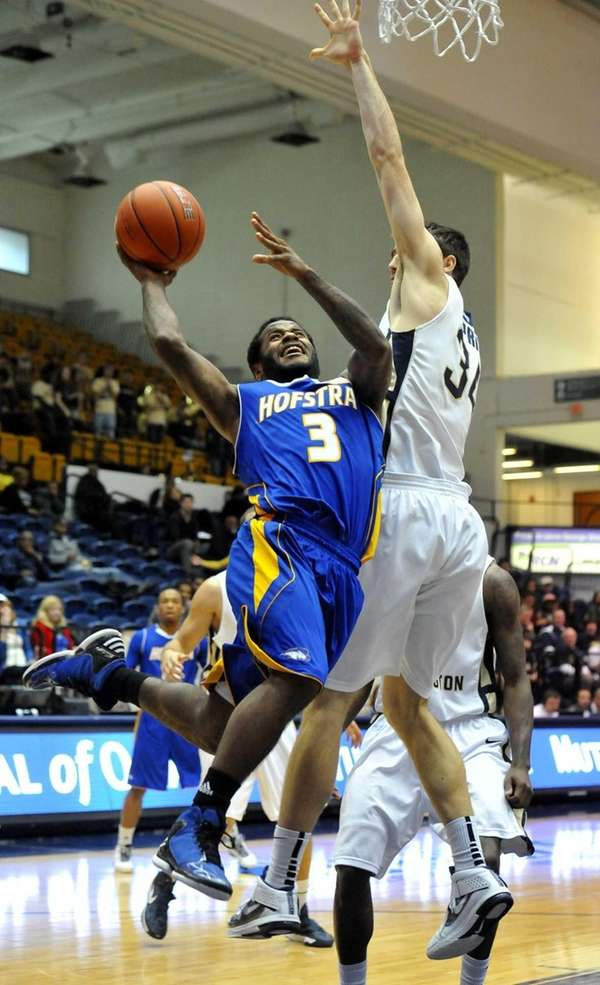 Hofstra's Stevie Mejia puts up a shot against
