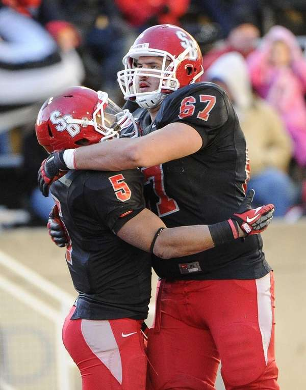 Stony Brook's Miguel Maysonet, left, is congratulated by