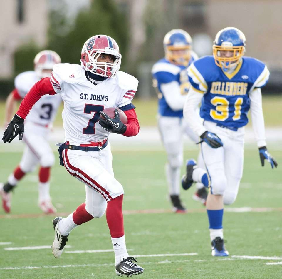 St John the Baptist's Bryan Sinclair gains yardage