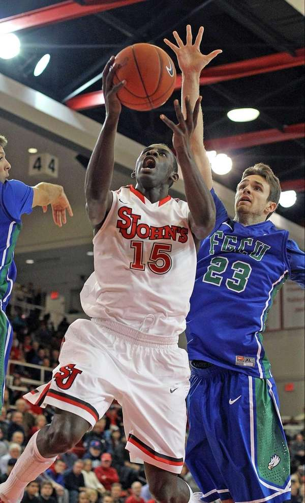 St John's Sir'Dominic Pointer gets past Florida Gulf