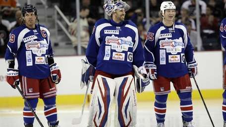 New York Team goalie Henrik Lundqvist, of Sweden,